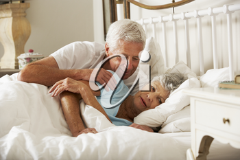 Senior Man Tries To Be Affectionate Towards Wife In Bed