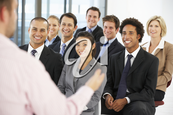 Group Of Business People Listening To Speaker Giving Presentation