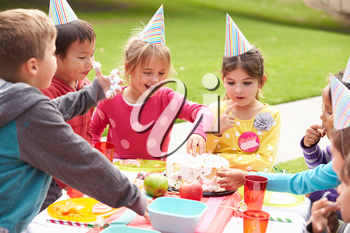 Group Of Children Having Outdoor Birthday Party