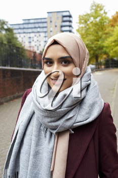Portrait Of British Muslim Woman In Urban Environment