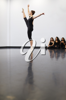 Female Ballet Student At Performing Arts School Performs For Class In Dance Studio