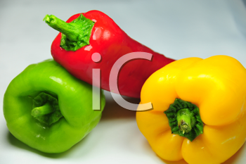 colorful green, red, and yellow whole bell peppers