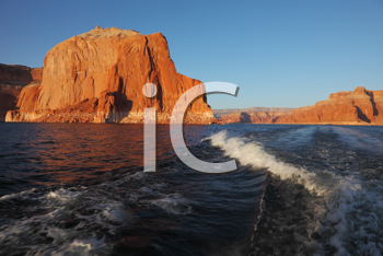 Travel voyage by boat on Lake Powell.  Scenic wave at the stern of the ship. Arizona, USA. Sunset