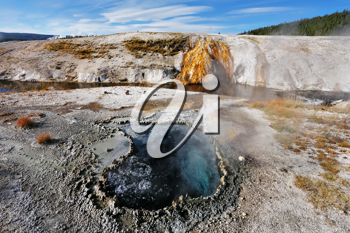 Yellowstone National Park. Famous fumaroles with hot water azure.