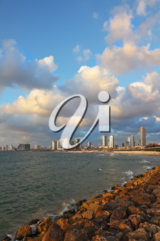 Magnificent panorama of the waterfront promenade in Tel Aviv. Sunset on a windy and cloudy day in May