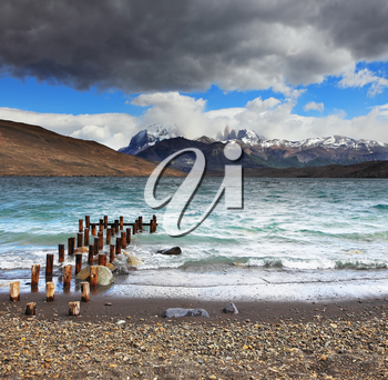 Storm clouds and strong winds in Laguna Azul. Boat dock on the lake. National Park Torres del Paine in Patagonia, Chile