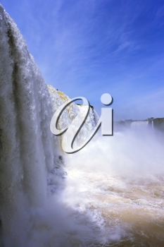 White whipped foam of water and a thin mist over the water. The most high-water waterfall in the world - Iguazu. The picture is taken by lens Fisheye