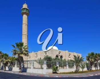 TEL AVIV, ISRAEL - MAY 2, 2014: Spring Tel Aviv promenade. Arab mosque and minaret against a bright blue sky