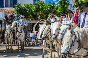 Sent-Mari-de-la-Mer, Provence, France - May 25, 2015. Convoy - guards on white horses before the start of the parade. World Festival of Gypsies. The concept of ethnographic tourism