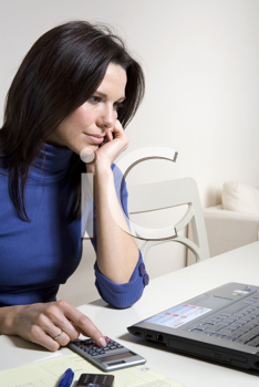Royalty Free Photo of a Woman Paying Her Bills Online