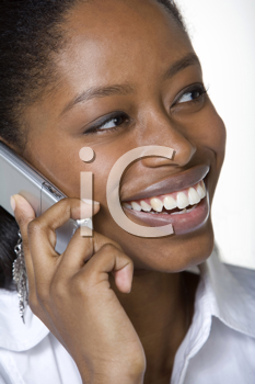 Royalty Free Photo of a Black Woman Talking on a Cell Phone