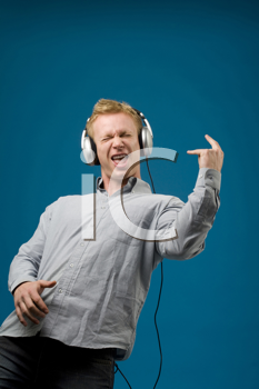 Royalty Free Photo of a Man Rocking Out to Headphones Music