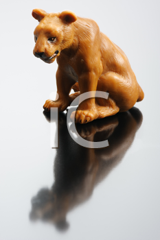 Royalty Free Photo of a Plastic Figurine of a Lioness
