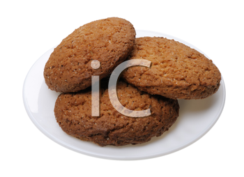 Brown Cookies on a white plate, isolated