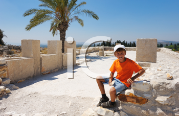 Royalty Free Photo of a Boy on the Remains of Settlements on the Hill Megiddo