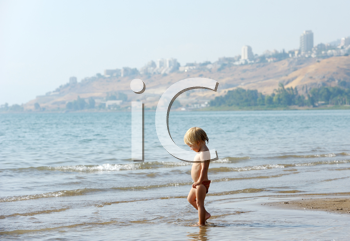 Royalty Free Photo of a Child in the Water at Lake Kinneret