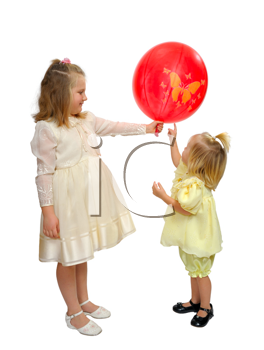 Girls in fancy dresses play with a red balloon.