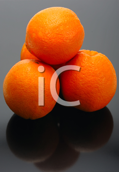 Royalty Free Photo of Oranges Piled on Black