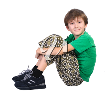 Sitting boy, isolated on a white background.