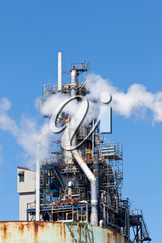 Refined Petroleum Petrochemical Plant Smokestack Pipeline with blue sky