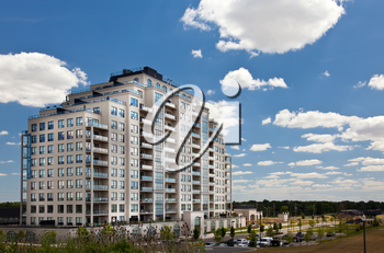 Modern residential high rise building subdivision neighbourhood blue sky perspective view