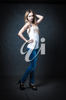 a young blonde wearing jeans and jacket full body shot
