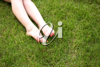 Womans bare feet on the fresh green grass