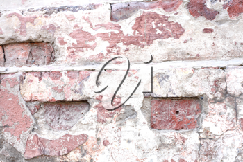 Old dilapidated brick wall of red brick
