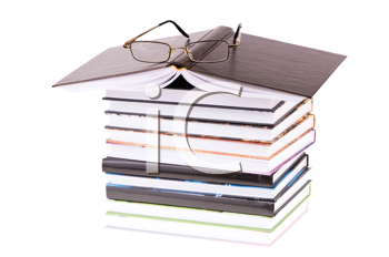 stack books with glasses isolated on white background