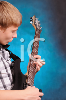 Royalty Free Photo of a Teenager Playing Guitar
