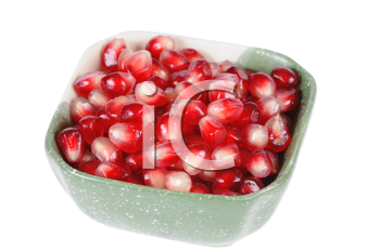 Pomegranate grains in a plate isolated on white background