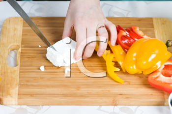 Royalty Free Photo of a Person Preparing a Salad