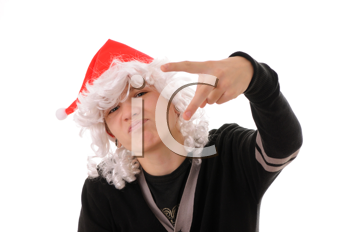 Royalty Free Photo of a Teenager Wearing a Santa Hat