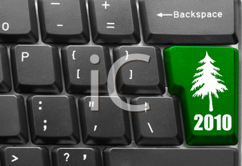 Royalty Free Photo of a Keyboard with a 2010 Christmas Tree Button