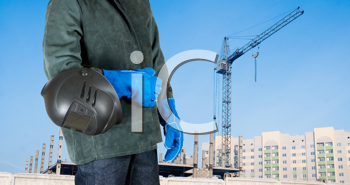 Royalty Free Photo of a Welder Standing In Front of a Building