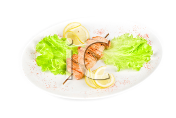 salmon kebab at plate isolated on a white background