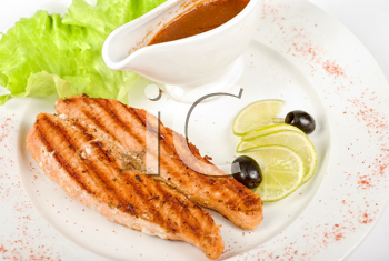 Royalty Free Photo of Grilled Trout Steak With Salad