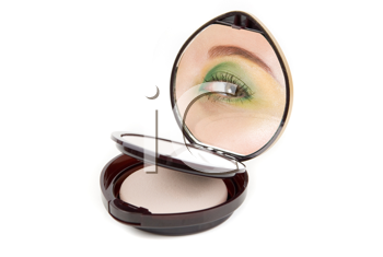 Cosmetic powder with woman eye at mirror isolated on red background