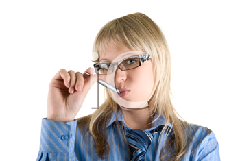 Royalty Free Photo of a Woman With a Pen in Her Mouth