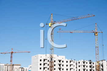 Royalty Free Photo of a Crane and Building Under Construction