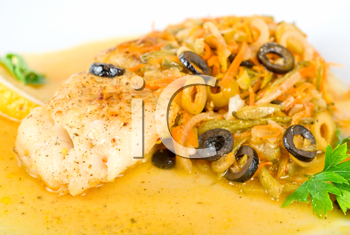 Royalty Free Photo of a Pike and Vegetable Dish
