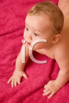 Royalty Free Photo of a Baby Boy Laying on a Towel