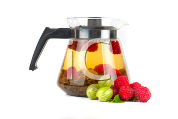 Teapot with fruit tea and berries on a white background