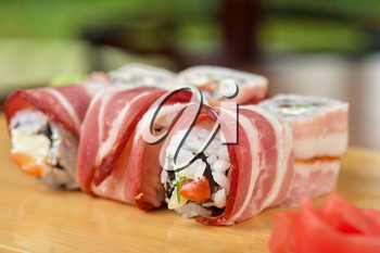 Japanese cuisine - sushi roll with bacon