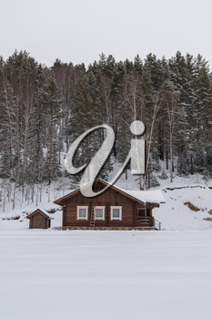 Winter holiday house in forest. Clean air, rest and relaxation. Unity with nature.