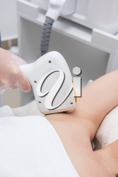 Laser epilation of armpits, hair removal cosmetology procedure. Health and beauty concept.