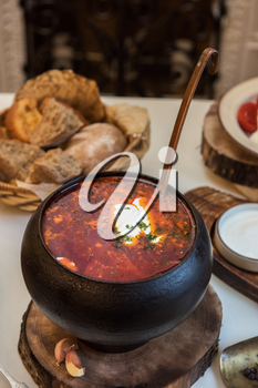 Russian borsch at pot on the table