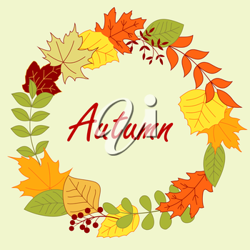 Colorful autumnal leaves arranged in a round frame border with red, gree, yellow and orange and shrubs, decorated by berries