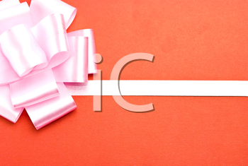 Royalty Free Photo of a Red Christmas Gift With a Bow