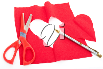 Royalty Free Photo of a Red Cloth With a Heart Cut Out of the Center, a Pair of Scissors, and a Pen